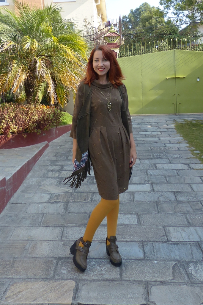 Earthy brown dress worn with long fringed vest and mustard tights
