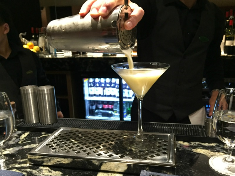 Cocktail being poured into a glass