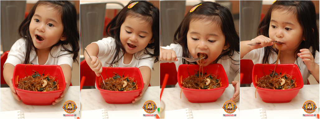 toddler eating noodles