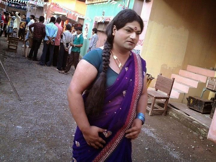 boys wearing saree