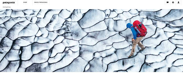 Jon Lang hikes through a snow wall that looks like a snow brain with his chacos on.