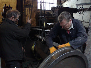 Lifting the axle into the ex Consett ironworks wheel lathe