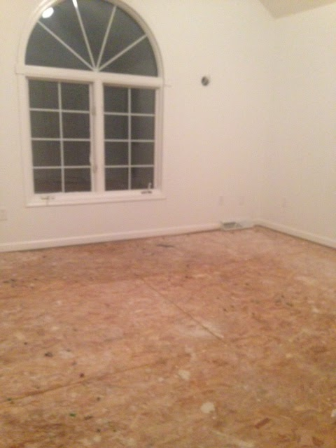 before pic of master bedroom after we removed carpet to prepare for hardwood flooring