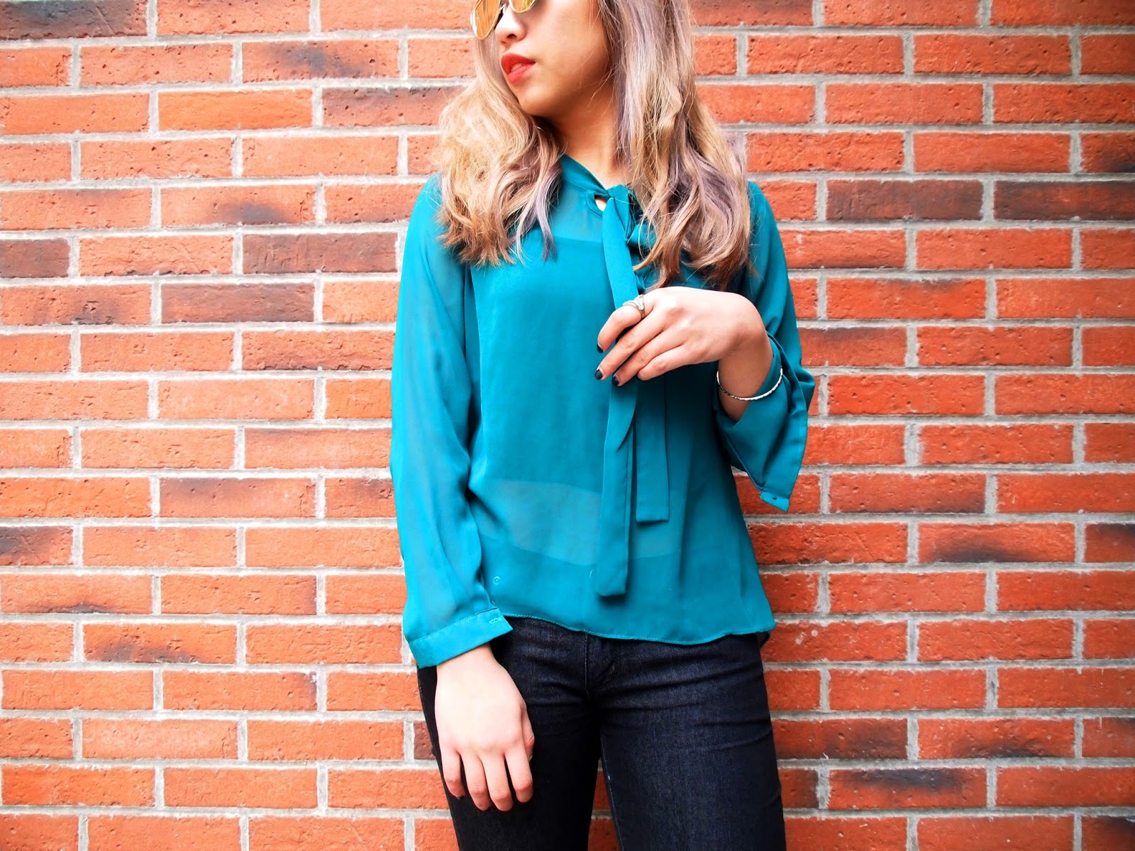 This is a photo of styling sheer blouse with jeans by Sidney Scarlett from www.sidneyscarlett.com