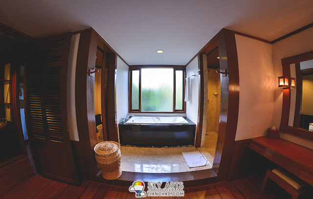 The spacious toilet with a bath tub in the middle - Tanjong Jara Resort