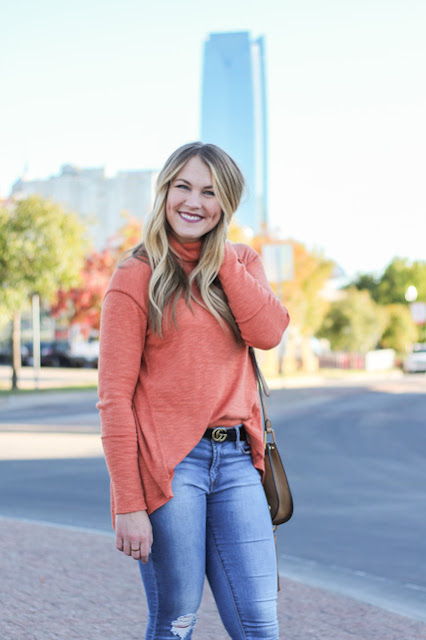girl wearing orange sweater in okc