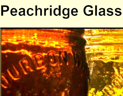 rear lighting causes orange glass Bourbon bottle on left, yellow glass on right to glow