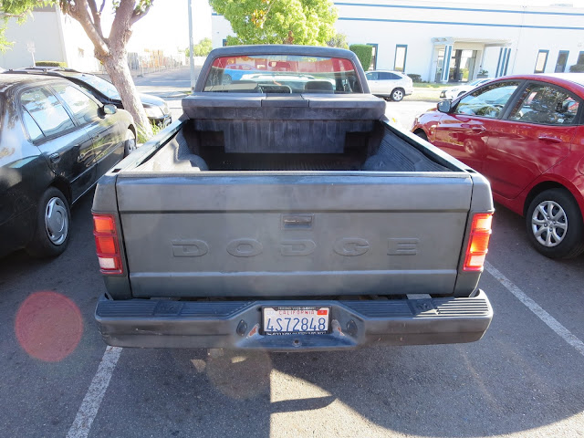 Dull, faded paint on 1993 pickup before complete repaint at Almost Everything Auto Body.