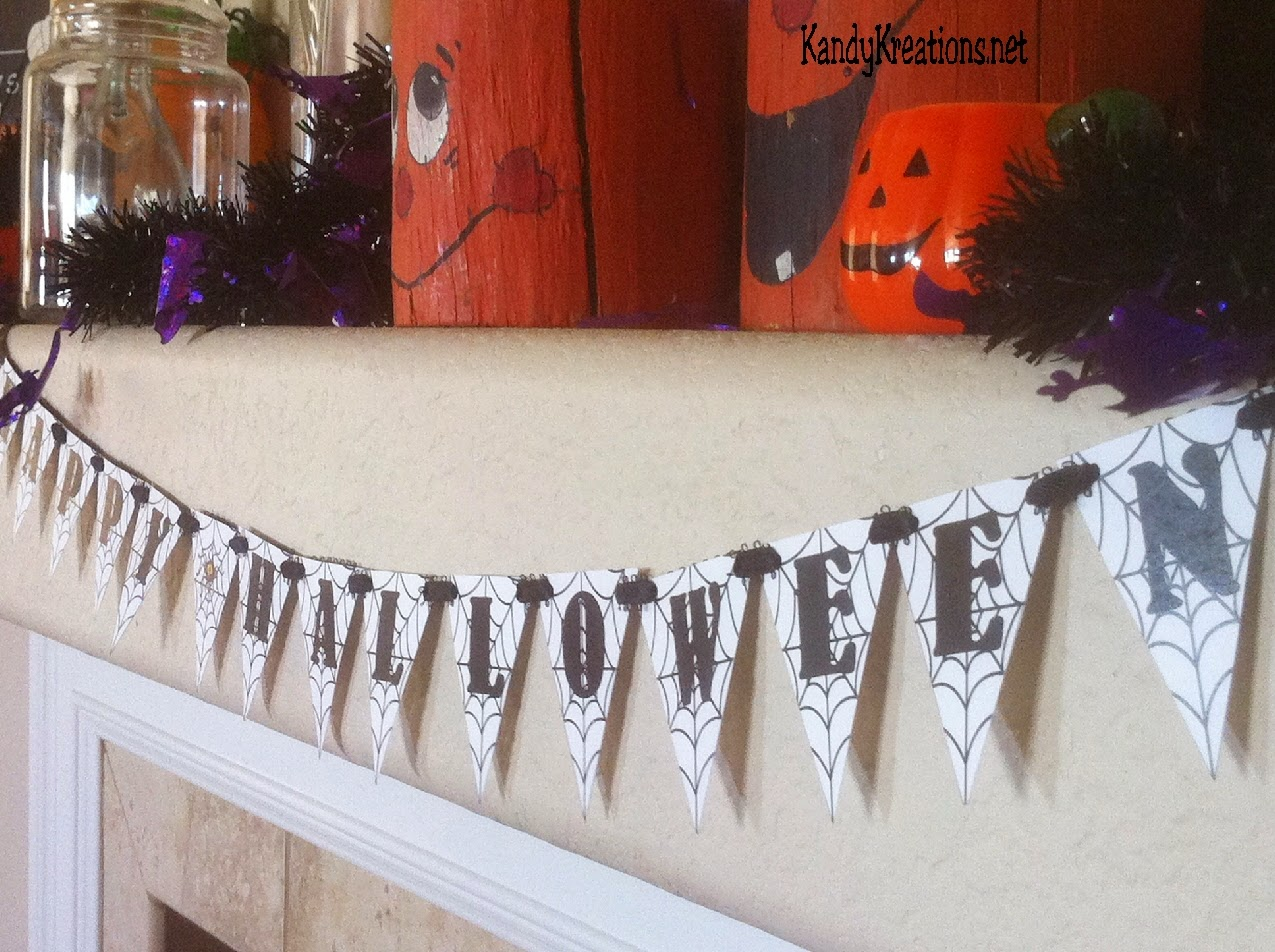 Decorate your mantel for Halloween with thrift store finds and .  You can make a Thrifty Halloween Mantel that will be scarily cool with this Spider Banner and unique jars found for cheap around your house and neighborhood.  You'll have a fun mantel with a bit of scare.