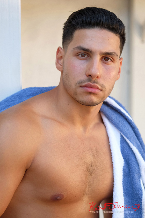 Mid to head-shot in colour with beach towel like a Roman god. Male modelling portfolio shot on Location in Sydney Australia by Kent Johnson.