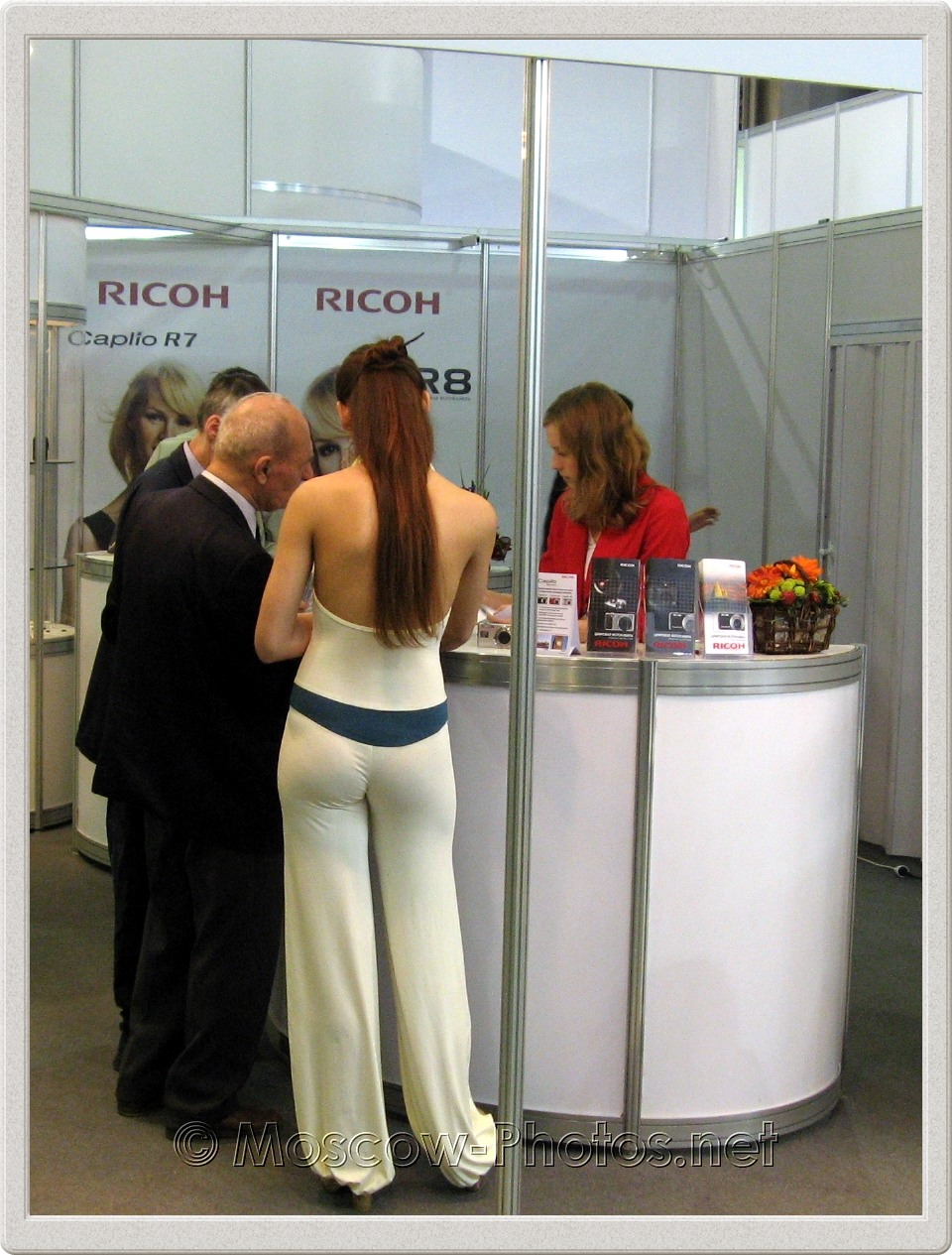 Promotion model in white suit at Photoforum