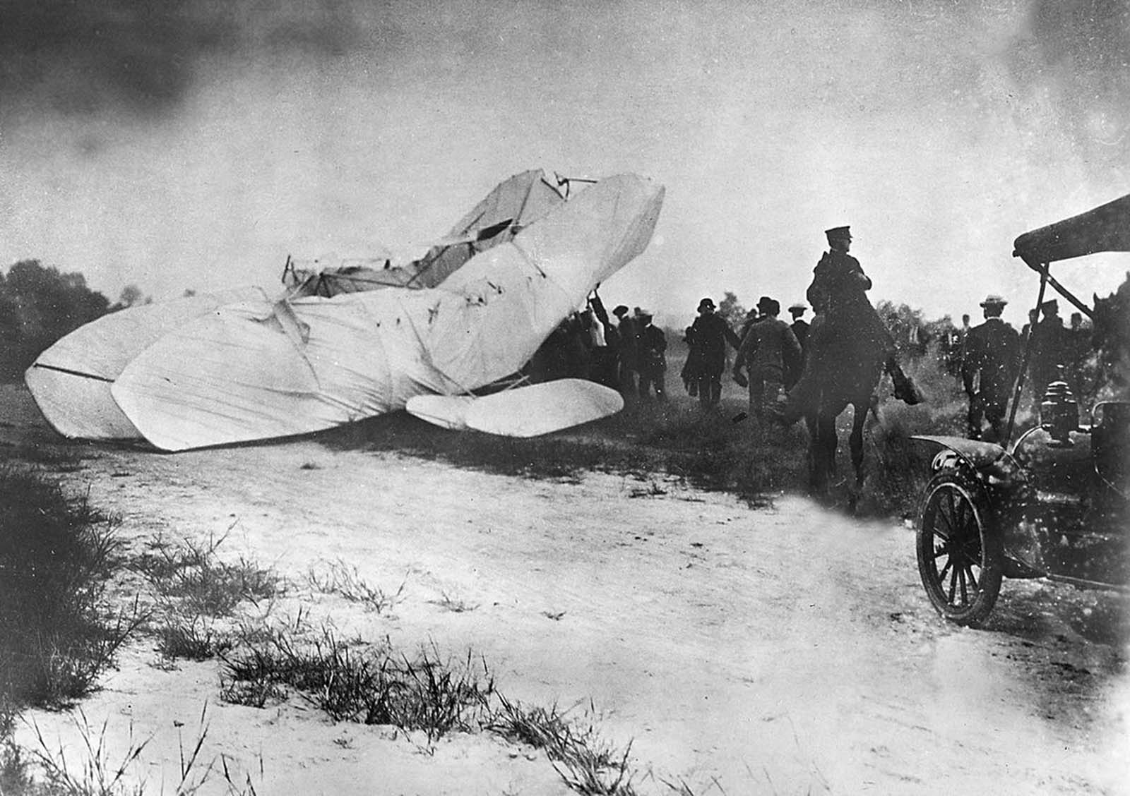 Troops of the U.S. Army Signal Corps rush to the site of a crashed plane to recover the pilot Orville Wright and his passenger, army observer Lieutenant Thomas E. Selfridge, from the wreckage on September 17, 1908, in Fort Myer, Virginia. The plane crashed during a demonstration flight at a military installation, making Lt. Selfridge, who died from his injuries, the first fatality of a military airplane crash. Orville suffered a broken left leg and four broken ribs.