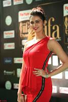 Meenakshi Dixit in Red One Shoulder Red Zipped up gown at IIFA Utsavam Award 69.JPG