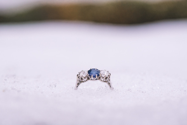 Blue and white diamond engagement ring in the snow