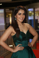 Raashi Khanna in Dark Green Sleeveless Strapless Deep neck Gown at 64th Jio Filmfare Awards South ~  Exclusive 109.JPG