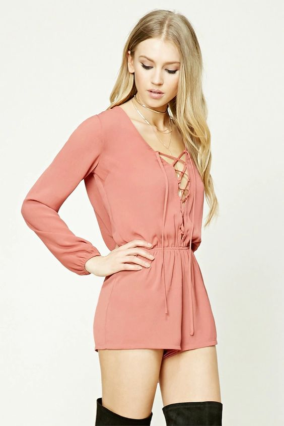 Liquid Markets - Style Deals - A woven romper featuring a lace-up front, V-neckline, an elasticized waist, and long elasticized sleeves.