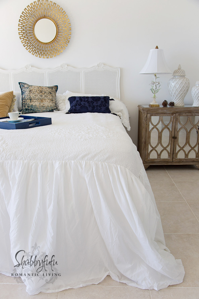 white coverlet with puddle skirt