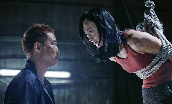 Simon Yam and Kara Wai in a scene from MRS K (2017)
