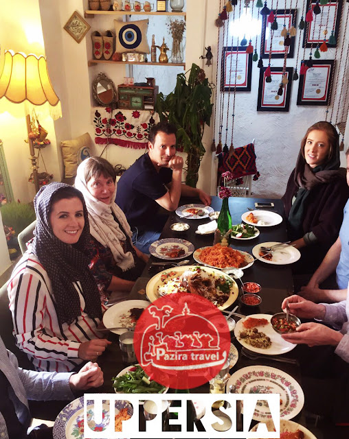 Travelers gathering in an Iranian restaurant.