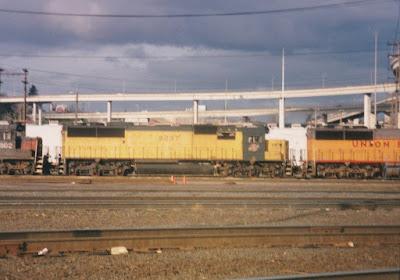 Chicago & North Western SD60 #8037 at Albina Yard in Portland, Oregon, in March, 1997