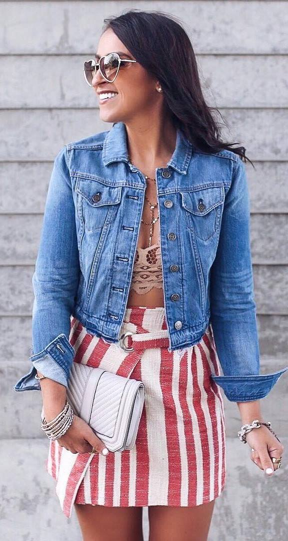 casual outfit idea / denim jacket + bag + striped skirt + nude crop top