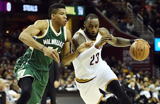 Giannis Antetokounmpo defending LeBron James