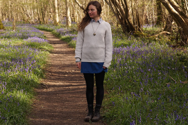 country girl in bluebell wood