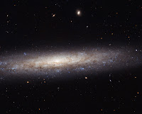 Hubble Catches a Dusty Spiral in Virgo