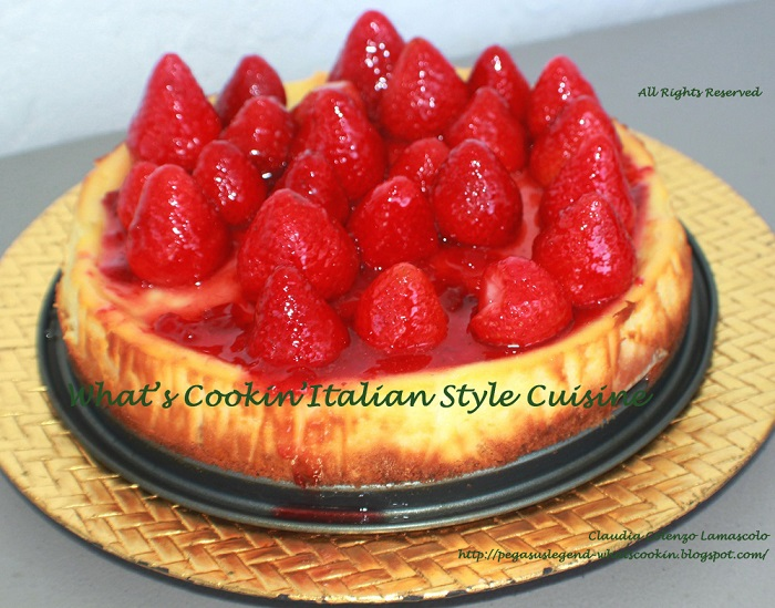 Strawberry cheesecake a copycat from Utica New York wiith whole strawberries and glazed