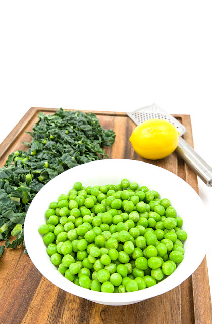Kale and peas on cutting board