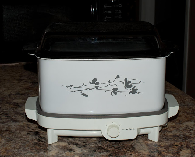 A slow cooker with multiple uses from slow cooking to making bacon and eggs on the hot plate.