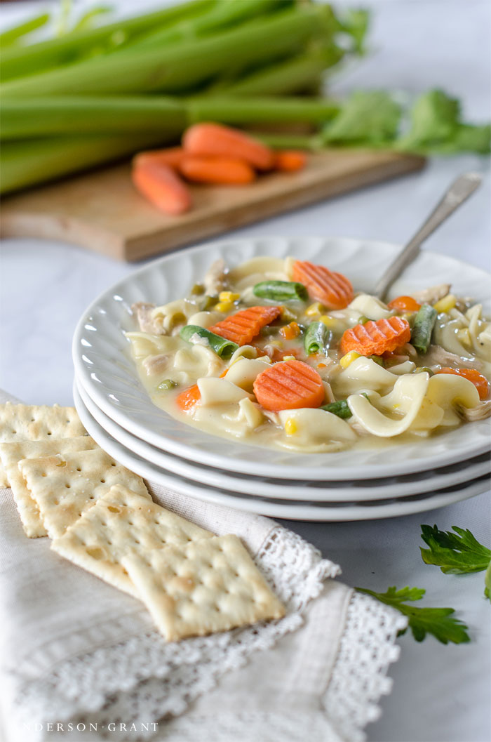 Make this easy Creamy Chicken Noodle Soup with vegetables for supper tonight!  Find the slow cooker recipe at www.andersonandgrant.com