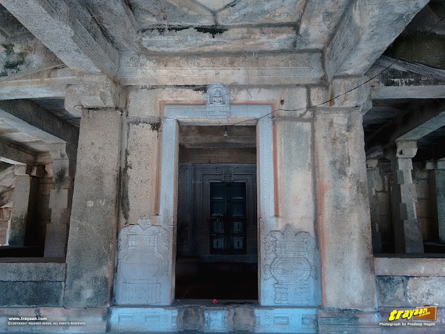 Entranceway to the temple through the front porch, with simple bas-relief decorations