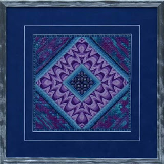 canvas work embroidery in a diamond shaped abstract design
