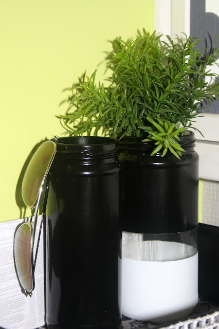 frasco de vidro com planta