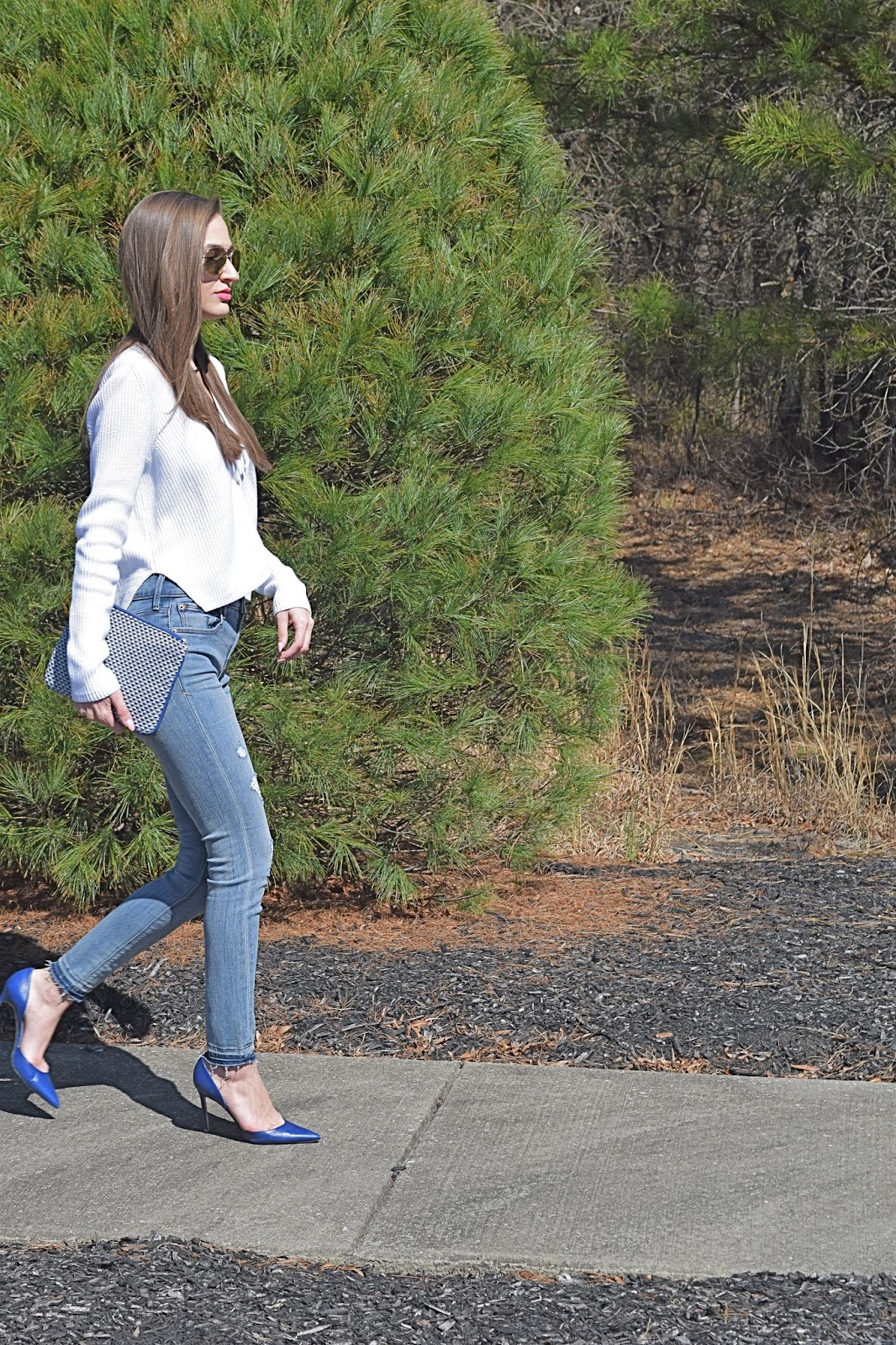 wearing express lace up white sweater, express distressed hem jeans, target yellow tassel clutch