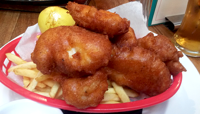 A basket of fried fish and chips