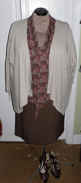 After finishing the Burda skirt, I started on this Simplicity 1945 ...