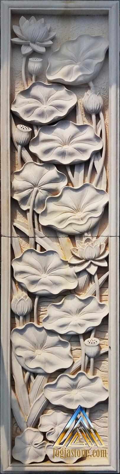 Relief dari batu alam paras jogja / batu putih motif bunga lotus