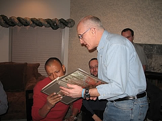A man persuading other to accept his viewpoints by showing his evidence in a book
