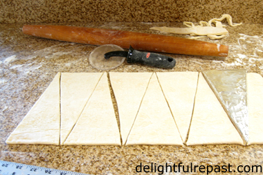 How to Make Croissants - A Tutorial (this photo - cutting with pizza wheel and template) / www.delightfulrepast.com