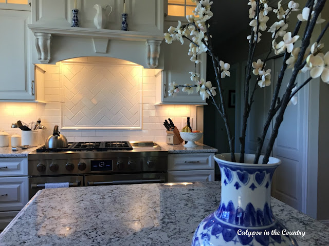 White kitchen with blue and white accessories