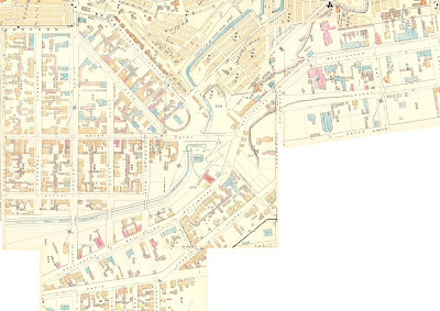 1878 Ottawa Fire Insurance maps, various plates compiled into a mosaic and cropped to show the area with extent Sally (Lyon, east), Maria (Laurier, South), Broad (west of Booth, West) and the south shore of the Ottawa River (North). The streets, building outlines, and notable geographic features are drawn approximately to scale, with streets named and buildings colour-coded according to construction (wood, etc). From the east, Wellington Street continues past Bay Street, then half a block later makes a 30 degree turn south, where it intersects with the downhill portion of Sparks Street and a projection of Concession Line (now Bronson Avenue at the Garden of the Provinces). Wellington continues to the east abutment of Pooley's Bridge, where it turns further south again, then makes two more gradual turns southwest just west of Commissioner Lane (now Street) and at Hill Street (now Brickhill, in the LRT staging area) where it converges upon Maria Street (now Albert Street; Maria is an extension of Laurier). Individual bridges cross the aqueduct at Bridge (now Booth), Lloyd and Cathcart West (now Lett), all of which intersect with Wellington. Sherwood, between Bridge and Broad, does not extend across or south of the Aqueduct. The point where Wellington Meets Maria/Albert/Richmond Road is not shown on the map.