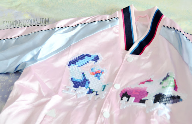 Powder pink and pastel sky blue satin souvenir jacket from SheIn, a dupe of the Evisu Fusion jacket, with colorblocked silky sleeves, pixel embroidery, and denim paneling.