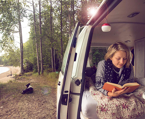 reading a book in the van