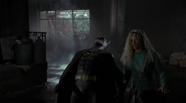 In the middle of fleeing the bad guys, Batman decides to do the limbo with a non-existent pole. He loses.