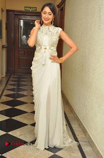 Actress Pragya Jaiswal Stills in Beautiful White Dress at turodu Audio Launch  0062.JPG
