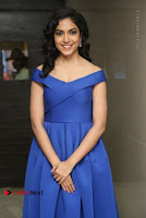 Actress Ritu Varma Pos in Blue Short Dress at Keshava Telugu Movie Audio Launch .COM 0060.jpg