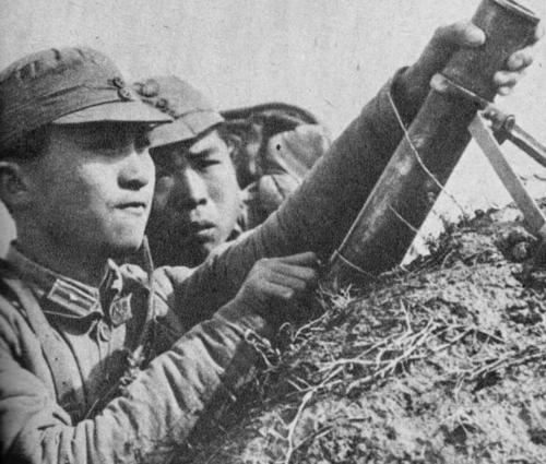 WW2 Chinese nationalist troops using small mortar 1943