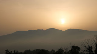 The day begins in a hazy glow